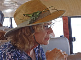 Stacy with her newly decorated hat -  a cricket made from a palm leaf