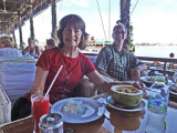 Judy and Alan having fish amok (a curry) for lunch soon after arriving in Phnom Penh, Cambodia from Chou Doc, Vietnam