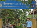 Sally at the Customs Office/Border Checkpoint/ Police Station at the border between Vietnam and Cambodia