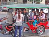 Cambodian families being transported by tuk-tuk - Phnom Penh, Cambodia