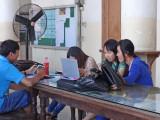 Students working at a computer at the Royal University of Phnom Penh - Cambodia