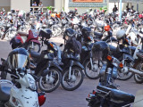 Parking lot at Royal University of Phnom Penh, Cambodia. Helmets were left on bikes - no concern helmets would be stolen.