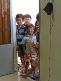 Children peaking in the door of the room of several of our sponsored young ladies (college students) - Phnom Penh, Cambodia