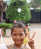 A young vendor at a service plaza - a few hours outside of Phnom Penh, Cambodia