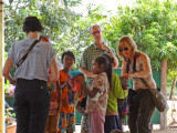 Sally, Fran  and Alan talking to children while we stopped for lunch on our way to see our sponsored high school young ladies