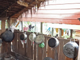 Hanging pans make up the kitchen area inside the house of one of our sponsored young ladies (high school student)