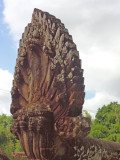 The revered nine-headed Naga, a snake-god, at one end of the Spean Praptos Bridge