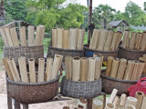 After the woman seen in the previous photo prepared this bamboo, it was filled with sticky rice.