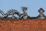 Dragon roofline on a building in the Temple of Lecture - Hanoi, Vietnam