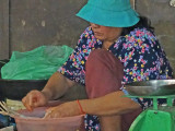 A woman preparing food at the Old Market in Siem Reap, Cambodia