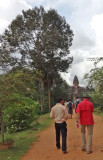 Alan and our group's guide Borin walking toward the 9th century c.e. Bakong Temple (background) in the Roluos Group, Cambodia