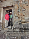Fran and Alan at the tower of the 9th century c.e. Bakong Temple - in the Roluos Group, Cambodia