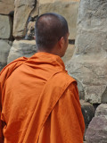 A Hindu monk at a wall of the 9th century c.e. Bakong Temple - in the Roluos Group, Cambodia