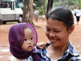 Woman and child in small village near the Roluos Group of temples and monuments