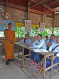Class of young Cambodians learning English from a Hindu monk.