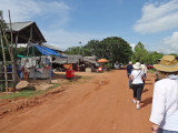 Stacy, Helen, Stan and guide Borin walking in a small village - while traveling to Tonle Sap Lake, Cambodia