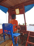 The captain of our boat - while exploring the floating village on Tonle Sap Lake in the Siem Reap Province of Cambodia