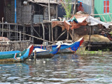 Houses (on stilts/piles) and boats in a stilted village on Tonle Sap Lake in the Siem Reap Province of Cambodia