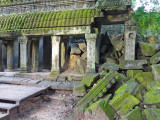 Ta Prohm Temple - exterior overrun by moss - in Angkor, Siem Reap Province, Cambodia
