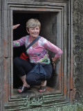 Janet as a statue of a deity :-) at theTa Prohm Temple in Angkor, Siem Reap Province, Cambodia