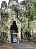 A bus squeezing through the East gate entrance to the walled city of Angkor Thom - Siem Reap Province, Cambodia