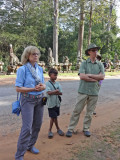 Stacy and Alan joined by a local onlooker while viewing the statues on the road to Angkor Thom - Siem Reap Province, Cambodia