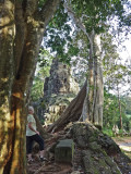 Helen viewing the face on a shrine while she was walking to the center of Angkor Thom - Siem Reap Province, Cambodia