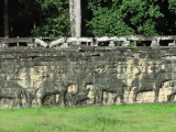 The Terrace of Elephants' retaining wall in Angkor Thom showing elephants & riders (mahouts) - Siem Reap Province, Cambodia