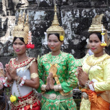 Tourists can pay to have their photo taken with these women dressed in attractive Cambodian outfits - Angkor Thom, Cambodia