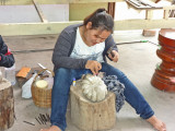An artisan preparing an item for sale at the stores located at our unscheduled shopping stop - Siem Reap Province, Camodia