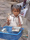 Cute little girl selling souvenirs - while we were walking on a road to Preah Khan, Angkor, Siem Reap Province, Cambodia