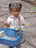 Cute little girl selling souvenirs while we were walking on a road to Preah Khan, Angkor, Siem Reap, Cambodia