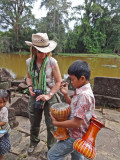 Fran & boy discussing his souvenir drums for sale -  while we were walking on a road to Preah Khan, Angkor, Siem Reap, Cambodia