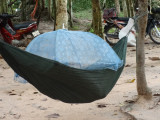 Sleeping vendor  - while we were walking on a road to Preah Khan, Angkor, Siem Reap, Cambodia