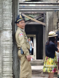 A police officer providing security at Preah Khan - Angkor, Siem Reap Province, Cambodia