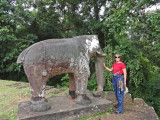 Judy next to a statue of an elephant at the East Mebon Temple - Angkor, Siem Reap Province, Cambodia