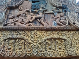 Bas reliefs: Upper: Combat between Vali and Sugriva. Lower: Finely detailed carving of an unidentified Hindu god -  Banteay Srei