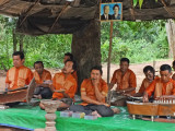 Men playing music for donations - near the temple grounds of  Banteay Srei, Angkor, Siem Reap Province, Cambodia