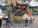 A woman preparing palm sugar (for sale) - on our way back to Siem Reap from Banteay Srei - Siem Reap Province, Cambodia