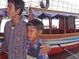 A man and his son in a floating village on Tonle Sap Lake - Siem Reap Province, Cambodia