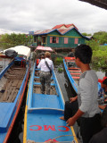 Janet getting on a shallow-bottom boat to visit Prek Toal, a bird sanctuary - Tonle Sap Lake, Siem Reap Province, Cambodia