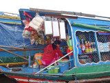 A floating store. This vendor went from floating house to floating house to sell her goods - Tonle Sap Lake - Siem Reap Province