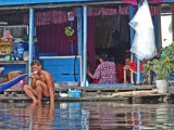 A guy brushing his teeth at a floating house, Tonle Sap Lake, Siem Reap Province, Cambodia