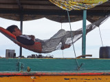 Close-up of the guy taking a nap seen in the previous photo  - Tonle Sap Lake Lake, Siem Reap Province, Cambodia