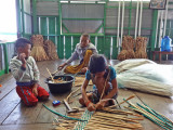 Two children and a man weaving water hyacinths for baskets & place mats sold at a floating gift shop we visited - Tonle Sap Lake