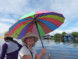 Helen in a sampan exploring more of the floating village on Tonle Sap Lake, Siem Reap Province, Cambodia