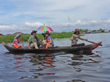 Fran and Alan in a sampan exploring more of the floating village on Tonle Sap Lake, Siem Reap Province, Cambodia