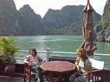 Judy and Fran relaxing  aboard the Treasure Junk in Ha Long Bay, Vietnam