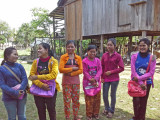 Our sponsored young ladies (high school students) with their colorful purses - rural village