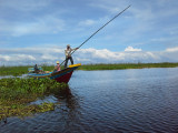 Fishermen near the flooded forest/wetlands next to Tonle Sap Lake - Siem Reap Province, Cambodia